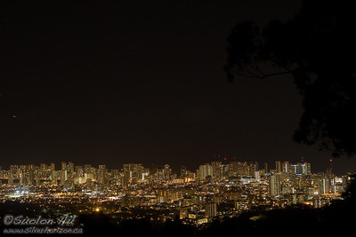 Waikiki at night as viewed from one of the stops along Round Top Drive.