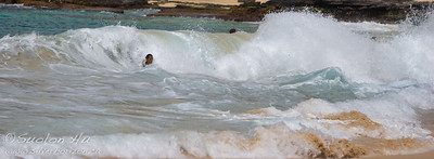 A local body surfing at Sandy Beach Park, Oahu