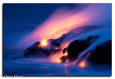 Lava Meets the Sea - Kileuea Volcano: lava flow from Kileuea into the ocean at night.