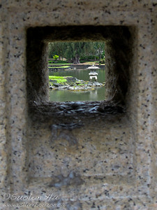 Looking through a stone monument at the Liliuokalani Gardens - Hilo, Hawaii