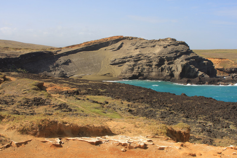 In a remote area along the southern coast of the Big Island, you find one of the few green sand beaches in the world.