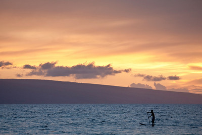 Paddleboarder at sunset near Lahina, Maui. The island in the distance is Lanai.