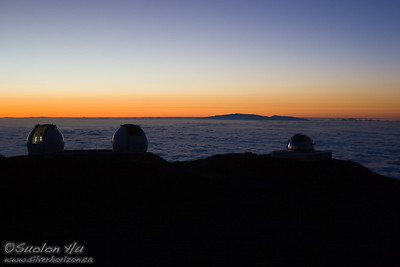 Maui in the distance as seen from the Mauna Kea Observatories.