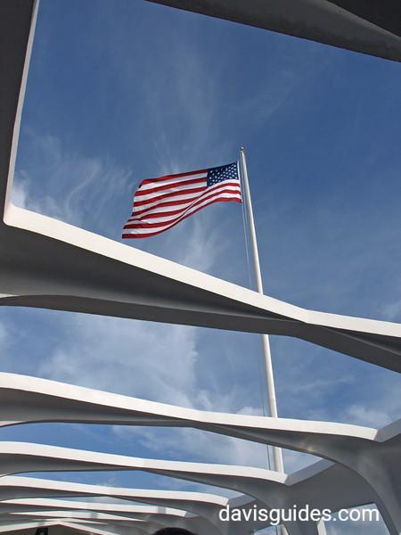 American flag flies above the Arizona Memorial