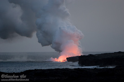 Lava from Kilauea Volcano flowing into the Pacific Ocean. This lava flow is east of Pu'u 'O'o (12 miles east of the summit) and outside the Hawai'i Volcanoes National Park.