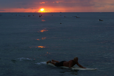 Surfing at sunset, Honolulu