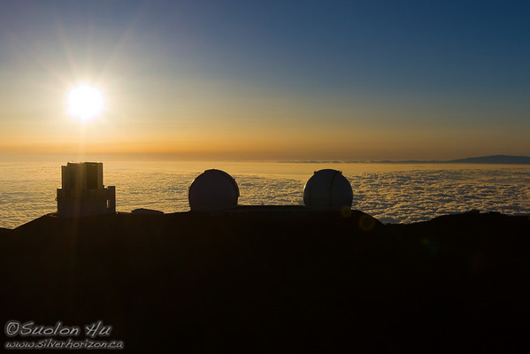 Mauna Kea Observatories at sunset.