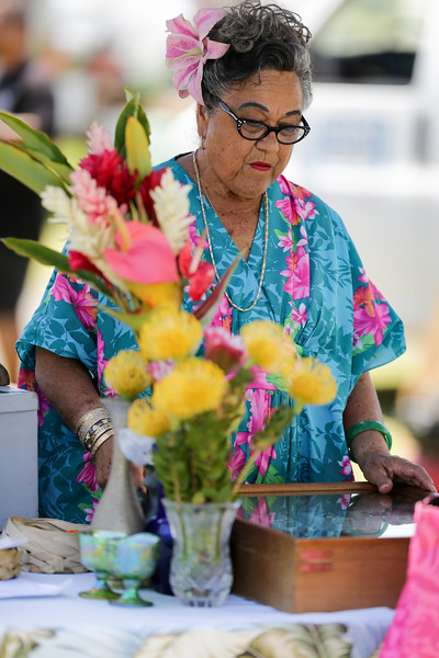 I love the images of this vendor! To me she represents the beauty of Hawaiian culture. My sister (aka my assistant) spotted her while I was photographing fruit stands.