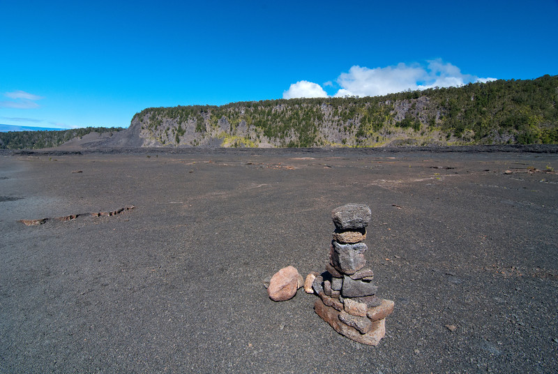 "<span id=""title"">Cairn</span> <em>Hawaii Volcanoes National Park</em> I've never seen so many cairns (trail markers) in one area before, but you really need them here. The terrain is pretty featureless otherwise."