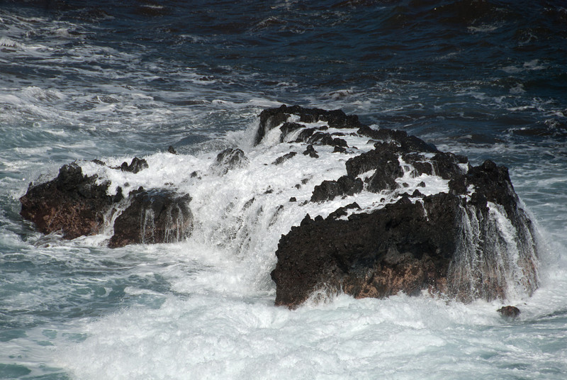 """<span id=""""title"""">White Water</span> <em>Onomea Bay, Hawaii</em> A cool rock in Onomea Bay that looked even cooler when waves crashed over it. The bay is along Old Mamalahoa Highway, North of Hilo."""