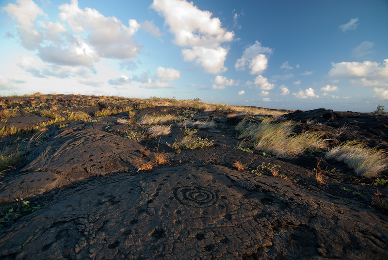 """<span id=""""title"""">Petroglyphs 2</span> <em>Hawaii Volcanoes National Park</em> We learned that the small holes were carved for newborns, and their umbilical cord was placed in it. Neat, and kind of gross."""