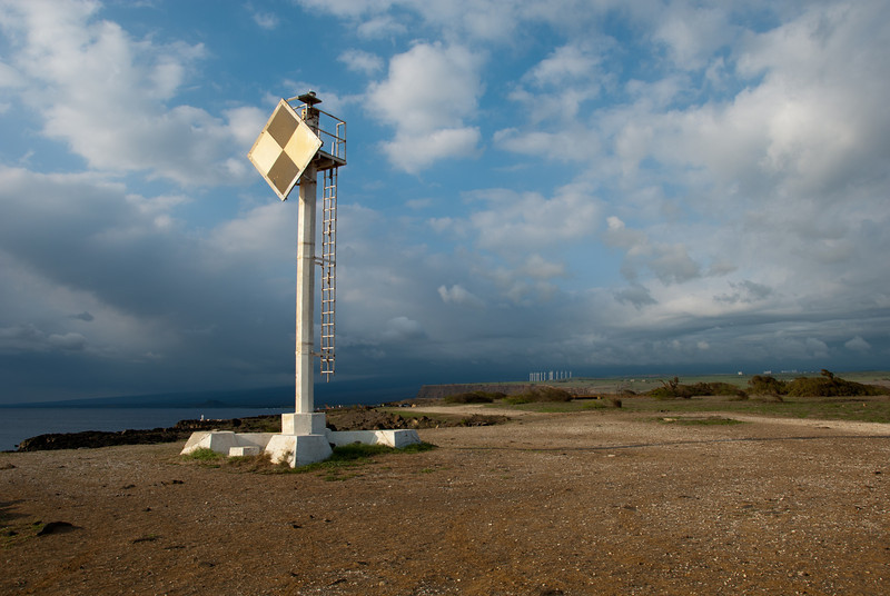"""<span id=""""title"""">Beacon</span> <em>South Point, Hawaii</em> Since it appeared to be non-electric, I'm not sure what purpose this South-facing sign-thing serves. It sure looked cool in the soft late-afternoon light, though."""