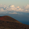 "<span id=""title"">Cinder Cone</span> <em>Mauna Kea, Hawaii</em> One of my favorite photographs from the trip. The red hues in the rock contrasted nicely with the clouds in the distance, especially with the almost-sunset light. This shot was taken as we hiked up a hill near the Mauna Kea visitors center to watch the sunset."