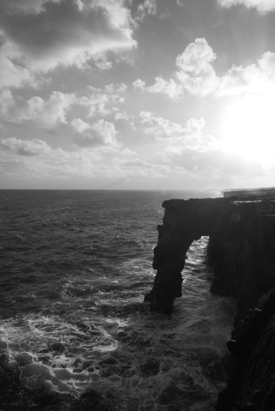"""<span id=""""title"""">Lava Arch</span> <em>Hawaii Volcanoes National Park</em> Although discouraged, you can go right out to the edge of the lava flow where it drops abruptly into the ocean. Even from the relative safety of the rock wall they have built, you can see this awesome arch. What's really frightening is that you can see down the side - the ocean has actually cut into the side."""