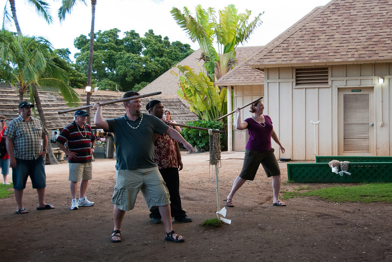 """<span id=""""title"""">White People Throw</span> <em>Paradise Cove Luau, Oahu</em> My wife and I trying to throw a spear (big dowel with a dull point) into a target (bale of hay). We failed, but got leis anyways."""