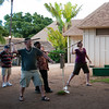 "<span id=""title"">White People Throw</span> <em>Paradise Cove Luau, Oahu</em> My wife and I trying to throw a spear (big dowel with a dull point) into a target (bale of hay). We failed, but got leis anyways."