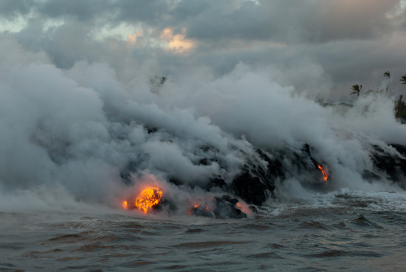 "<span id=""title"">Lava</span> <em>Lava Entry Point, Hawaii</em> Wow.  Here's where it all happens - molten rock pours into the ocean and instantly vaporizes sea water into giant plumes of steam. This was an incredible sight, and I highly recommend taking one of these lava boat tours. Although you can sometimes see a surface lava flow, your best bet is to take a boat here, where the lava emerges after traveling underground."