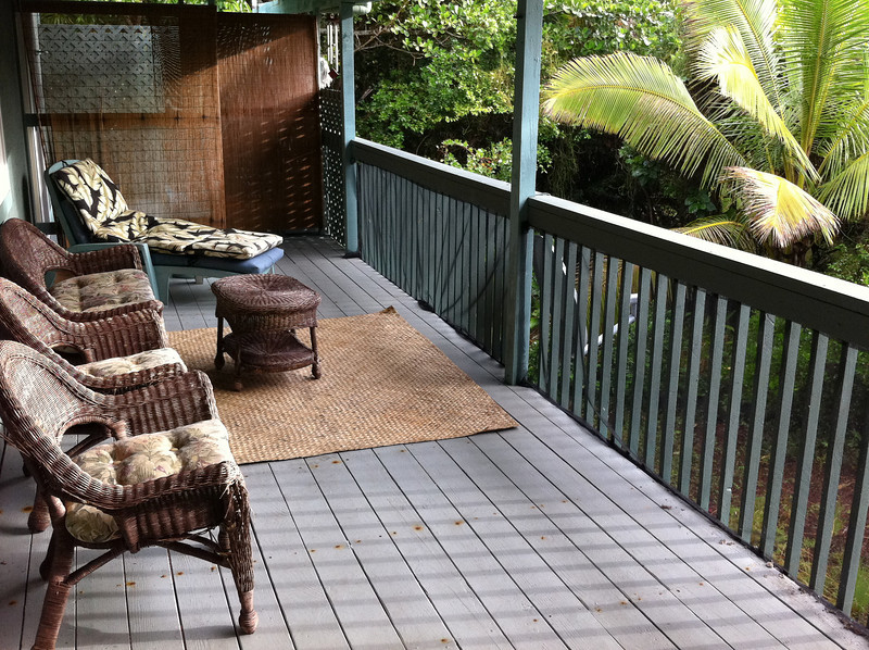 """<span id=""""title"""">Lanai</span> <em>Kaphoho, Hawaii</em> Here's the lanai (is it just the Hawaiian word for porch?) at the rental house we stayed at. I'd highly recommend it - <a href=""""http://www.vrbo.com/79299"""">VRBO #79299</a> It's within walking distance to the Wai' Opae tide pools, and you can hear the ocean. The only downside is the farther distance to other attractions like the National Park. This is no fault of the house, but I have to add that at night there was an incredible din from the ... crickets?... that live in all the trees. It sounded like there were millions of them! Each one very loud. Crazy."""