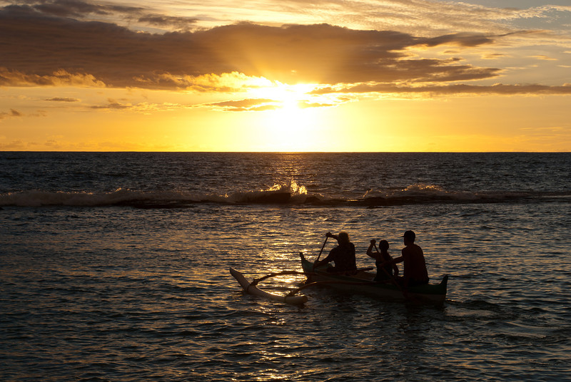 """<span id=""""title"""">Sunset Paddle</span> <em>Paradise Cove Luau, Oahu</em> After spear throwing, we moved onto a little canoe ride in the cove. It was beautiful, but kind of cheesy."""