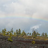 "<span id=""title"">Rainbow Pano</span> <em>Hawaii Volcanoes National Park</em> It rained like CRAZY the first day we visited the park. While unfortunate that we missed the craters (namesake of Chain of Craters road) because of downpours, we did get to see some great rainbows. The splash of color was very striking against the stark black landscape."