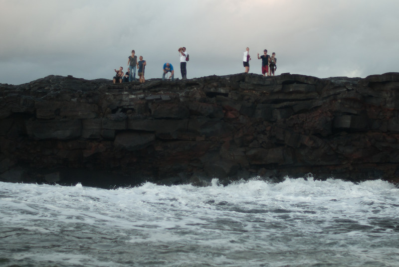"""<span id=""""title"""">Lava Viewers</span> <em>Lava Entry Point, Hawaii</em> These hikers were incredibly close to the lava entry point - I was a little jealous that they didn't have to endure the bobbing ocean in a little boat like we did. Then again, we got a better view :)"""