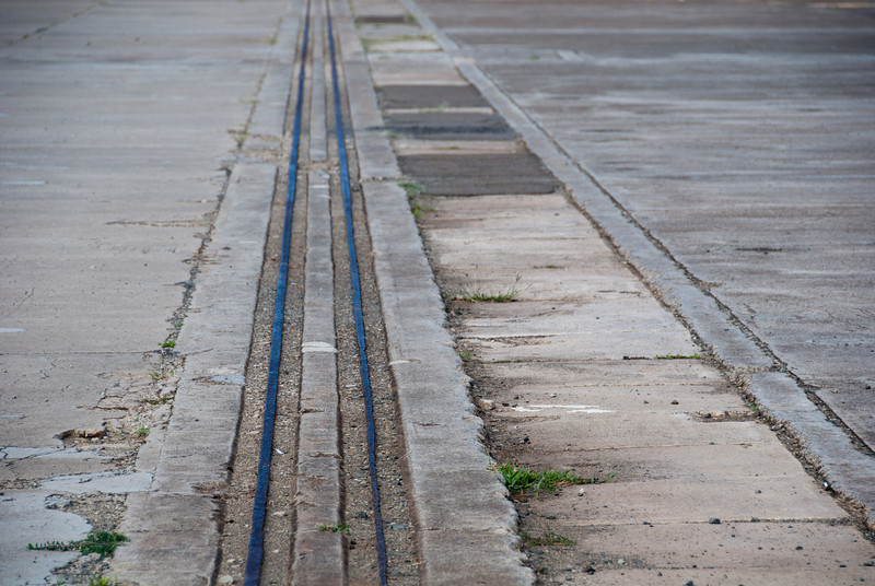 """<span id=""""title"""">Hangar Door Track</span> <em>Ford Island, Pearl Harbor, Oahu</em> There used to be a hangar here, and the doors of that hangar ran on this track. Near this spot, my cousin pointed out a spot where a bomb exploded from the attack on 12/7/41."""