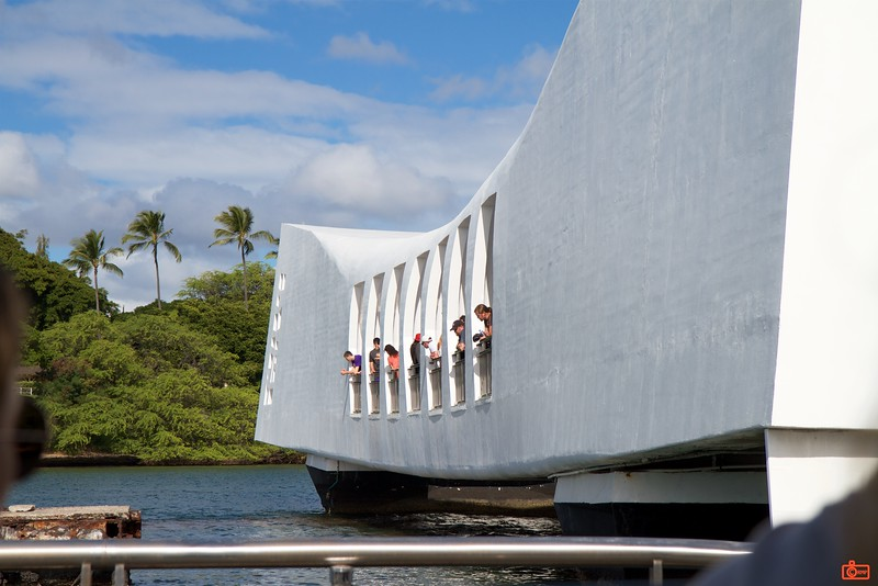 The U.S.S. Arizona memorial stands above the remains of the battleship that sank during the attack on Pearl Harbor.