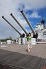 "Rosa on the aft deck of the battleship U.S.S. Missouri. Behind them are three 16"" main guns in the aft turret."