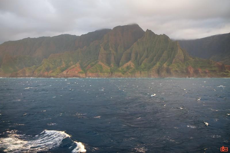 The Na Pali coast of Kauai illuminated by the setting sun.