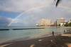 A late afternoon rainbow over the beach at Waikiki.