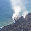 Lava from Kilauea as it spills into the ocean - from helicopter.