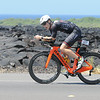 Nic heads North on Queen Ka`ahumanu Highway . Iconic lava fields in background. Photo from race sponsor.