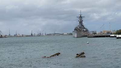 Foreground: sunken remains of the Arizona, Background: USS Missouri