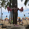 Duke Kahanamoku, credited with popularizing the sport of surfing, was heavily leied