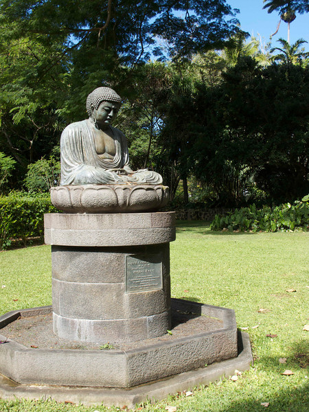 "This statue of Buddha is at the <a href=""http://www1.honolulu.gov/parks/hbg/fbg.htm"">Foster Botanical Garden</a>."