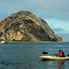 A kayaker in front of Morro Rock in Morro Bay.