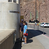 This is about as close to the edge of the wall as Ace wanted to get.<br /> <br /> As many as 20,000 vehicles a day drive across the 45 ft. wide top of the dam between Nevada and Arizona.