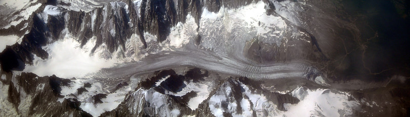 The Alps from the plane; panorama made of 3 images stitched together with Autopano Giga. <br /> <br /> Le Alpi dall'aereo; panorama realizzato unendo insieme 3 scatti singoli con Autopano Giga.