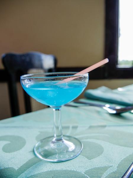 The  La Terraza's house specialty, Don Gregorio cocktail, a blend of blue curaçao and maraschino liqueur, Cojimar, Cuba, June 11, 2016.