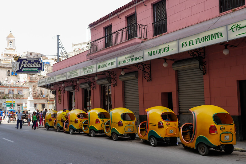 Cocotaxi lined up  in front of Floridita,  Hemingway's favorite bar, Havana, Cuba, June 11. 2016.