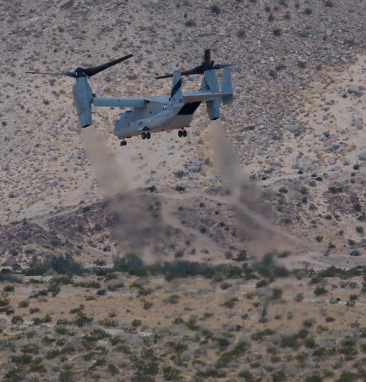 A Marines Plane was doing touch and goes on the desert just before Anza Borrego.  The idea is to have a shutter speed set to 1/125 or less so that the props are a blur..... sorry, I shake too much to do that.