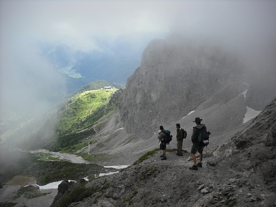 After five hours beneath overcast skies and light rain, standing on the pass, the clouds parted and we could see our cabin.  Would you believe it was still an hour away from there?