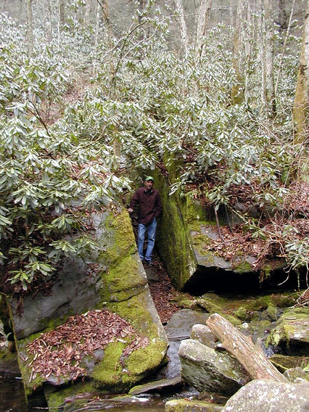 The path up to Fall Branch Falls passes between these huge boulders. You can see Kenny standing in the middle.  The path is overhung with rhododendron. <br /> Cherohala Skyway, Cherokee National Forest, TN 2008