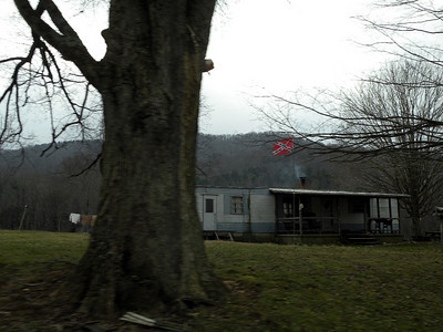 The Stars and Bars flies over this trailer home.  I wonder if this person's GG Grandfather was a Unionist or a Confederate? I bet they don't know either.