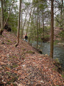 Kenny walking along the bank by Big Spring Creek as it heads toward the Caney Fork
