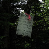 Sign found in the woods .  It details an observation made by the JPSP (Jay Peak Ski Patrol).