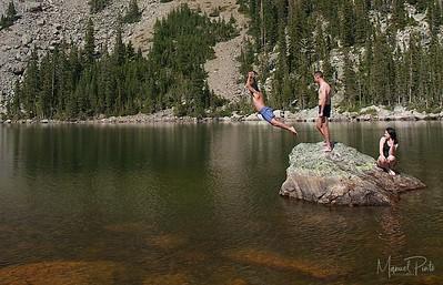 Manuel jumping into the lake