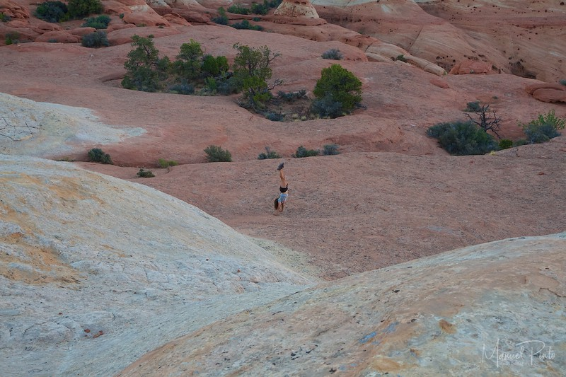 Maya doing handstands on the slick rock sandstone
