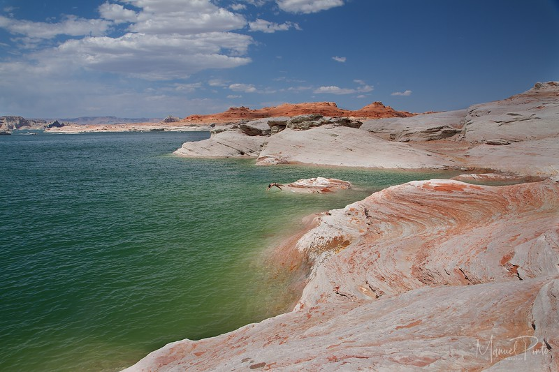 Sandstone shoreline at Lake Powell.  Maya diving.