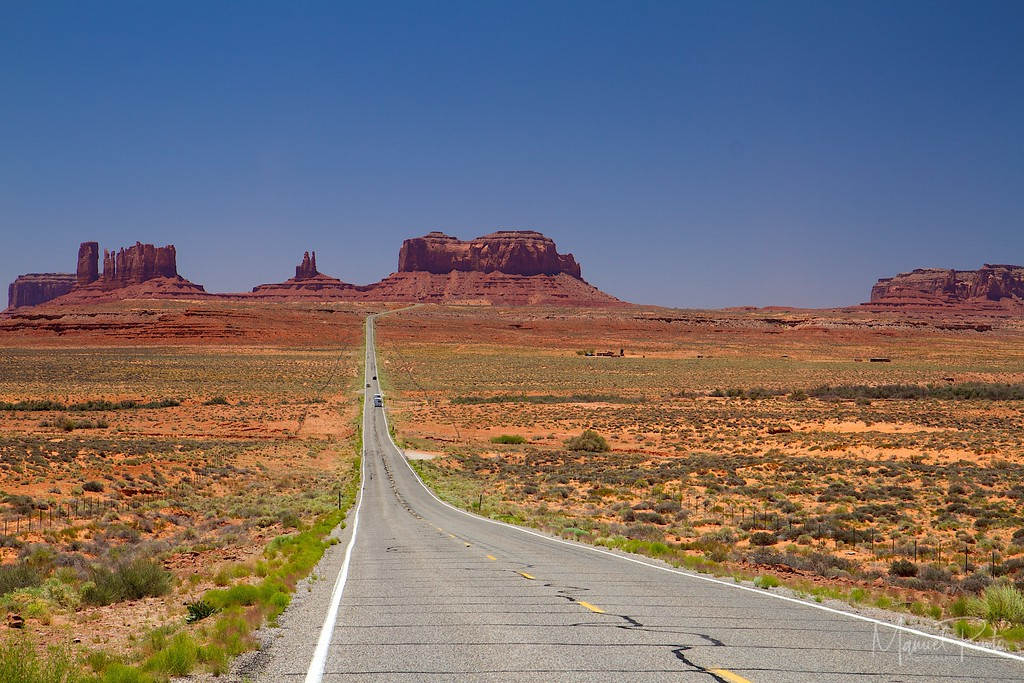 one of those many endless roads through the desert